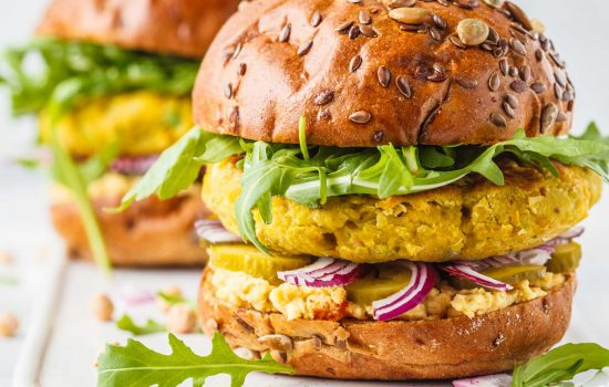 alt food market - Vegan chickpeas burgers with arugula, pickled cucumbers and hummus. Plant based diet concept. Shutterstock