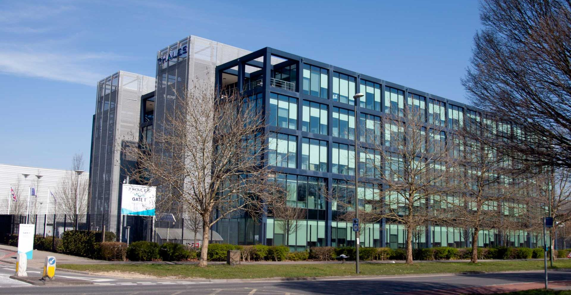 Crawley West Sussex March 26th 2020 Manor Royal industrial estate Thales main office block on next to the A23 - Shutterstock