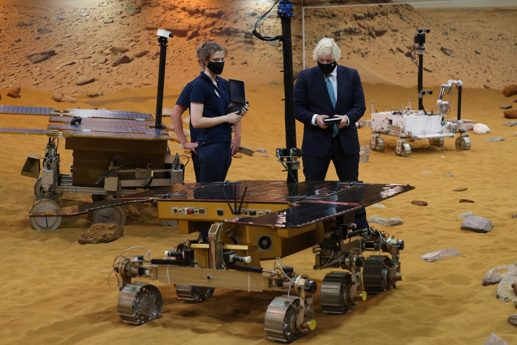 The Prime Minister meets engineers Yvonne Pickering and Matt Lisle on a mock surface of Mars to control one of the Mars Rovers at Airbus. Image courtesy of Ben Stevens / CCHQ / Parsons Media