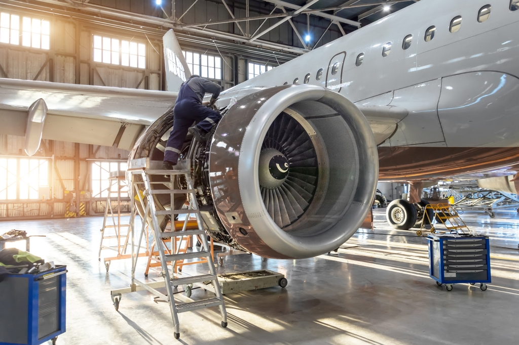 Mechanic specialist repairs the maintenance of engine of a passenger aircraft in a hangar. Image courtesy of Meggit PLC