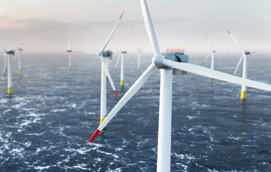 Offshore wind power and energy farm with many wind turbines on the ocean. Sustainable electricity production. 3D illustration. Image courtesy of Shutterstock