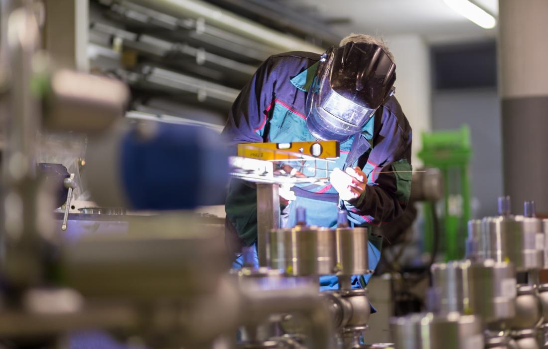 Factory worker welding. Image courtesy of Shutterstock